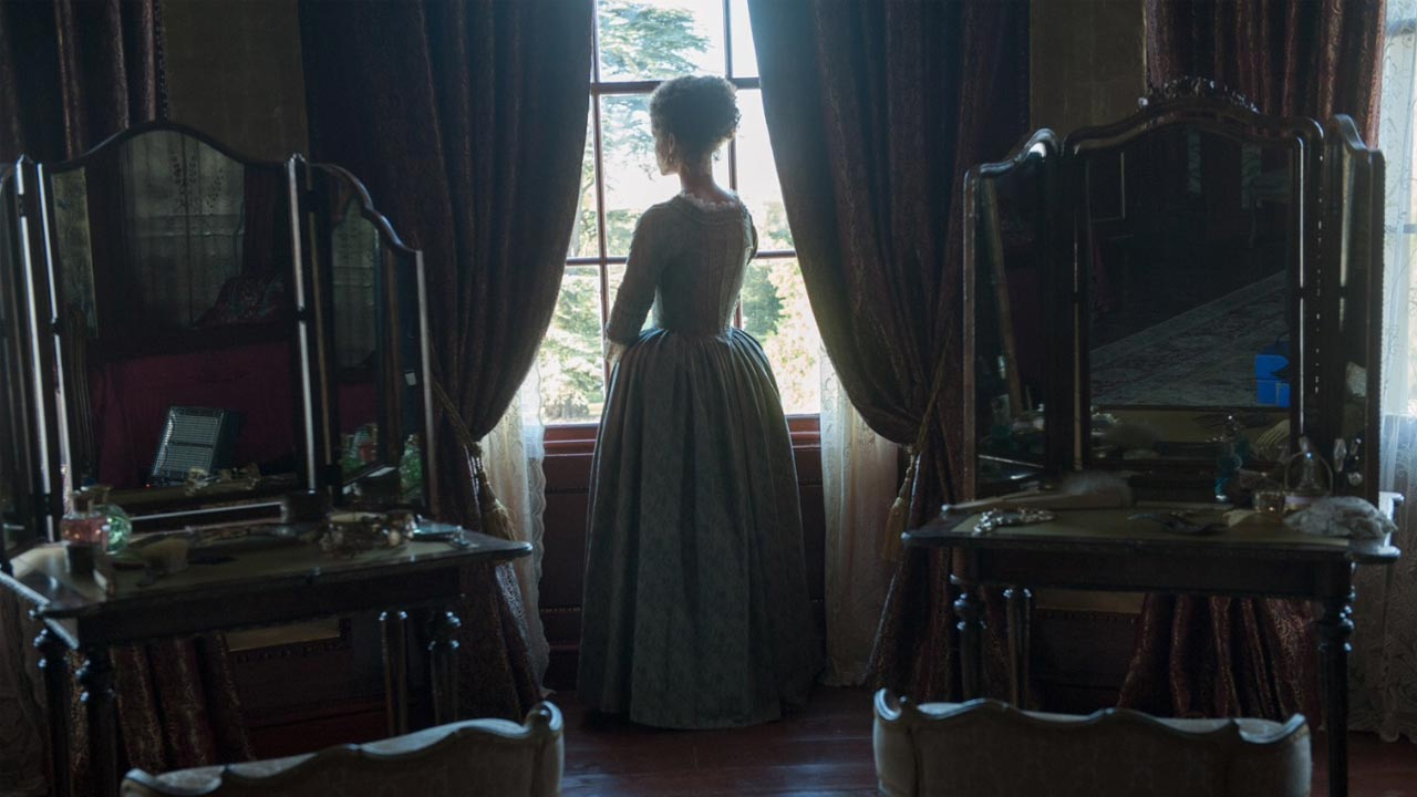 Screen shot of the Film Belle, with Belle looking out of the window